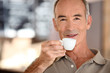 Elderly man drinking coffee