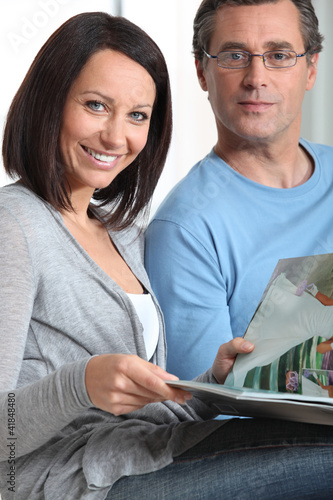 couple at home reading magazines
