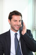 Businessman on the telephone smiling