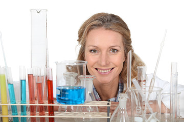 Woman with a variety of laboratory equipment