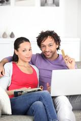 Couple with computer magazine