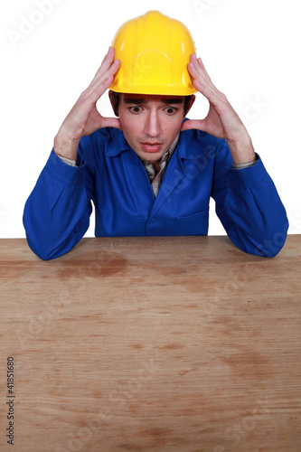 Stressed construction worker