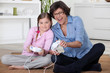 Girl and her grandmother playing computer games