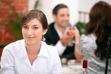 Woman eating in a restaurant
