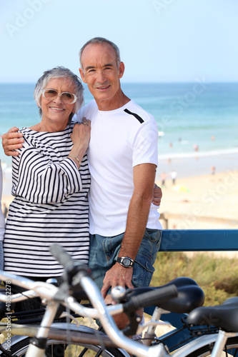 Mature couple embracing on promenade
