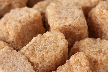 brown cane sugar cubes background close-up