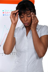 Businesswoman suffering from stress headache