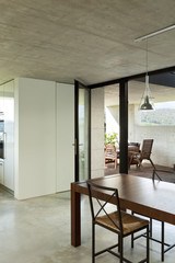 beautiful modern house in cement, interior, dining table, detail