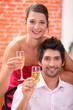 Elegant couple drinking champagne