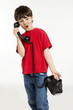 portrait of little boy on the phone, isolated on white
