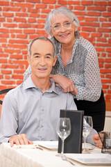 Elderly couple at restaurant
