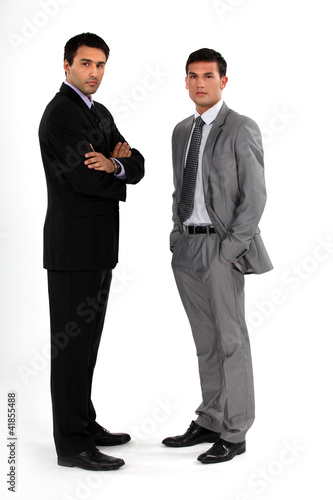 Two businessmen stood together