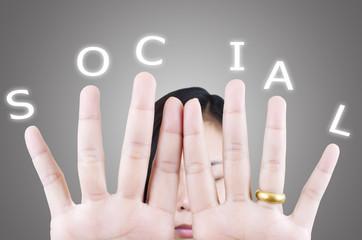 Business female pushing social word.