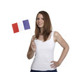 Attractive woman shows flag of France and smiles
