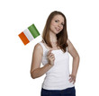 Attractive woman shows flag of Ireland and smiles