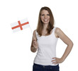 Attractive woman shows flag of England and smiles