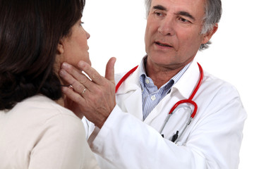 Woman being treated by doctor