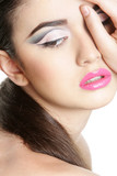 close up portrait of young beautiful woman with bright makeup is