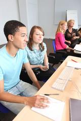 Teens in computer class