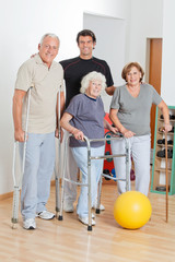 Portrait Of Disabled Senior People With Trainer