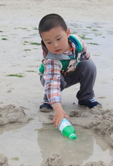 kid play in the beach