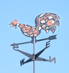 cock decorative on the roof of the arrow. Weather vane
