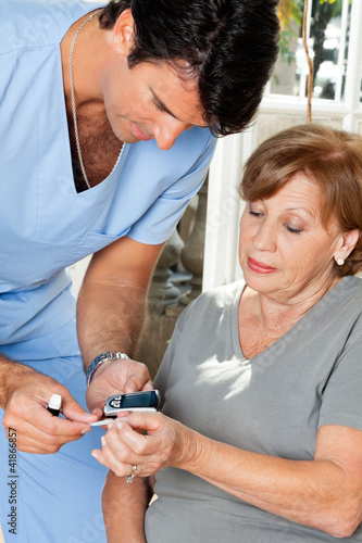 Male Nurse Measuring Glucose Level