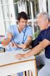 Male Nurse Checking Blood Pressure Of a Senior Patient