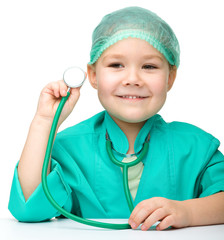 Little girl is playing doctor with stethoscope