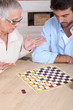 Senior woman playing chess