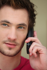 close up of young man with cell phone