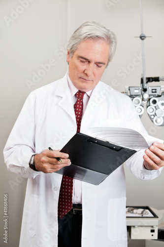 Optometrist Checking the Prescription