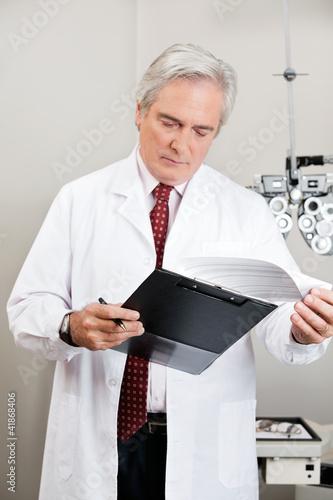 Optometrist Checking the Prescription