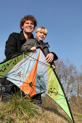 Father and son with a kite