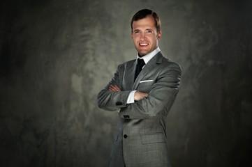 Happy man in grey suit
