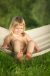 Adorable baby swing sitting in hammock