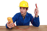 electrician using tester