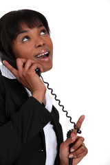 Businesswoman receiving good news over the phone