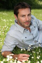Man relaxing in field