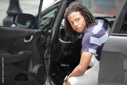 Man looking outside his car