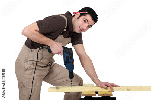 Handyman using a power tool