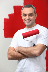 man happy to paint his wall