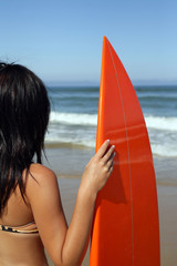 Woman holding a surf board