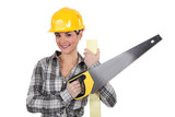 Female carpenter with saw
