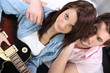 Horizontal image of girl with guitar