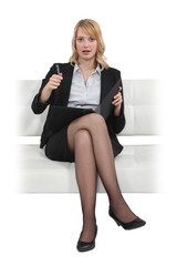 Blond businesswoman sat in chair with folder