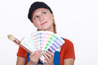 Woman choosing color on swatches