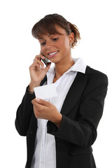 Woman ringing number on business card