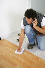 Tradesman talking with his client on the phone