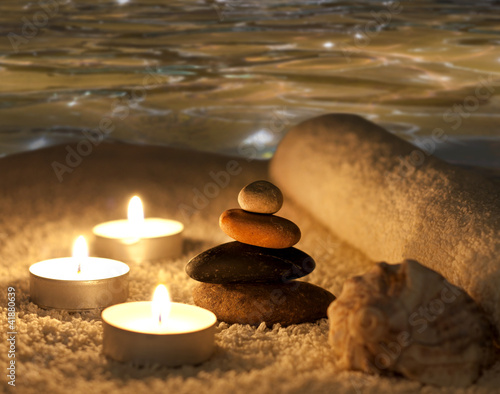 spa stones in night with water concept
